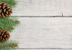 Christmas new year pine tree and cones decoration background. xmas and christmas on white wooden table backdrop copy spaces stock image