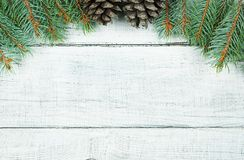 Christmas new year pine tree and cones decoration background. xmas and christmas on white wooden table backdrop copy spaces stock images