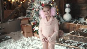 Christmas or new year. portrait of a little girl in Christmas decorations. the anticipation of the holiday stock footage