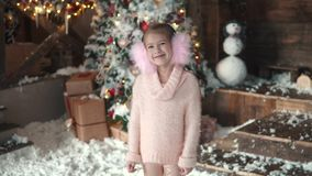 Christmas or new year. portrait of a little girl in Christmas decorations stock video footage
