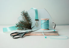 Christmas, new year. preparation for the holiday - notebook, scissors, thread, silk ribbon, branch of spruce . Stock Photo