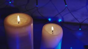 Christmas and new year presents, candles and two glasses champagne stock footage