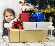 Christmas and New Year presents. Little girl opening presents for Christmas and New Year Royalty Free Stock Images