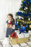 Christmas and New Year presents. Little girl opening presents for Christmas and New Year Stock Photos