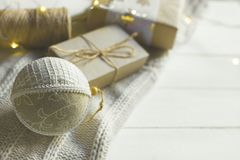 Christmas New Year presents packaging. Gift boxes in craft paper tied with twine hand made fabric ornament ball white sweater. Christmas New Year presents royalty free stock photography