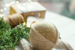 Christmas New Year presents packaging. Gift boxes in craft paper tied with twine hand made fabric ornament ball white sweater. Christmas New Year presents stock photos