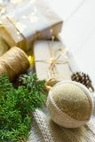Christmas New Year presents packaging. Gift boxes in craft paper tied with twine hand made linen fabric ball white knitted sweater stock photos