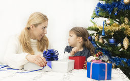Christmas and New Year presents. Young mother and daughter preparing presents for family for holidays Christmas eve and New Year Stock Photography