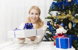 Christmas and New Year presents. Young mother preparing presents for family for holidays Christmas eve and New Year Stock Photography