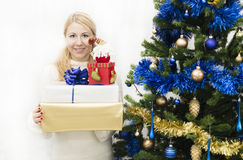 Christmas and New Year presents. Young mother preparing presents for family for holidays Christmas eve and New Year Stock Images