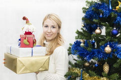 Christmas and New Year presents. Young mother preparing presents for family for holidays Christmas eve and New Year Stock Image