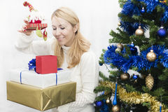 Christmas and New Year presents. Young mother preparing presents for family for holidays Christmas eve and New Year Royalty Free Stock Image
