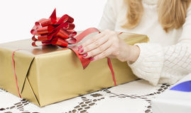 Christmas and New Year presents. Young mother preparing presents for family for holidays Christmas eve and New Year Royalty Free Stock Photos