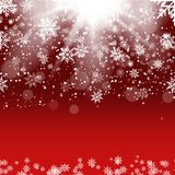 Christmas and New Year red background with falling gold snowflakes. Vector Stock Photo