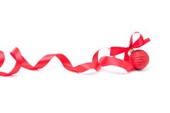 Christmas new year. Red Christmas ball with red ribbon on white background Stock Images