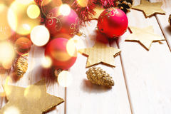 Christmas and New Year red balls decoration. Christmas and New Year red balls garland decoration background for text with gold bokeh Royalty Free Stock Image
