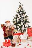 Christmas, new year, red Christmas balls. Beautiful Christmas decor on red satin cloth royalty free stock photography