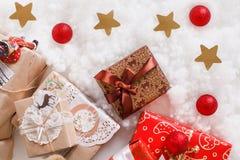 Christmas, new year, red Christmas balls. Beautiful Christmas decor on red satin cloth stock image
