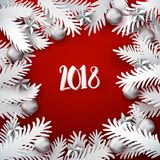 Xmas paper cut fir tree branches frame. Christmas and New Year red colored background with white paper art cut out fir tree branches decorated balls and stars Royalty Free Stock Photo