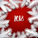 Holidays paper cut fir tree branches frame. Christmas and New Year red colored background with white paper art cut out fir tree branches decorated holiday balls Royalty Free Stock Image