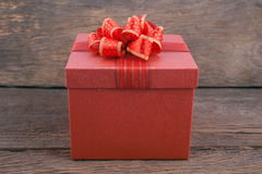Christmas and New Year red gift box  on vintage white wood background Stock Photo