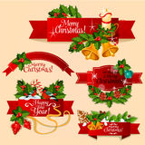 Christmas and New Year red ribbon banner set. Christmas and New Year ribbon banner set. Red label with holly berry and pine twig, candy cane, bauble ball, bell Stock Photo