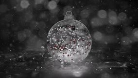 Christmas Rotating White Ice Glass Bauble snowflakes red balls background loop
