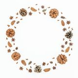 Christmas or New Year round frame with pine cones on white background. Flat lay, top view. Christmas or New Year round frame with pine cones on white background royalty free stock image