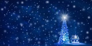 Christmas and New Year`s background with free space for text. Christmas tree with glowing lights on a garland and a shining star on the crown on a blue Northern stock image