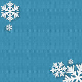 Christmas and New Year's background with place for your text. White snowflakes on a blue knitted background royalty free illustration