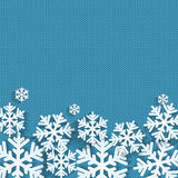 Christmas and New Year's background with place for your text. White snowflakes on a blue knitted background stock illustration