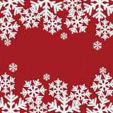 Christmas and New Year's background with place for your text. White snowflakes on a red knitted background stock illustration