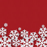 Christmas and New Year's background with place for your text. White snowflakes on a red knitted background royalty free illustration