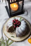 Christmas and new year`s cake with berries and lantern behind royalty free stock photography