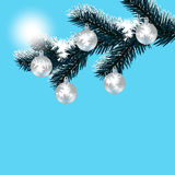 Christmas, New Year's card. Frosty winter day. Silver balls on a snow-covered tree branch. Royalty Free Stock Photography
