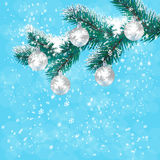 Christmas, New Year's card. Silver balls on a branch blue Christmas tree. Background of falling snow. illustration Royalty Free Stock Image