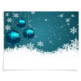Christmas, New Year s card. Three green shiny ball on a beautiful Christmas background. Hand among snowflakes. Christmas Stock Photos