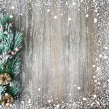 Christmas and New Year`s composition. The pine cones, spruce branches on a wooden background Stock Photos