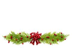 Top view of spruce branches, pine cones, red berries and bell on white background. Christmas and New Year`s composition. Top view of spruce branches, pine cones royalty free stock images