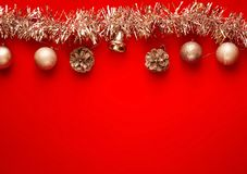 Christmas and New Year`s decor. Decorative Garland and silver balls on red background, concept of New Year`s holiday, close-upn. Christmas and New Year`s decor royalty free stock images