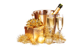 Christmas or New Year's Eve. Champagne and Gold Presents Stock Image