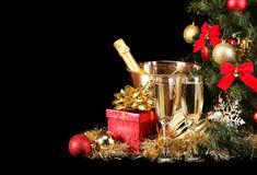 Christmas or New Year's Eve. Champagne and Presents over Black Stock Images