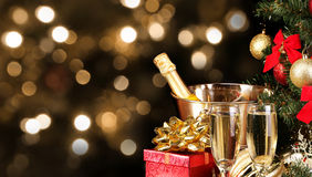 Christmas or New Year's Eve. Champagne and Presents over Black Royalty Free Stock Image