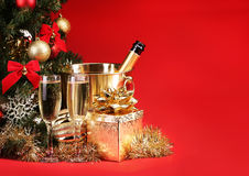 Christmas or New Year's Eve. Champagne and Presents over Red Bac Stock Image