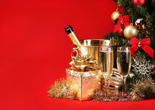 Christmas or New Year's Eve. Champagne and Presents over Red Royalty Free Stock Images