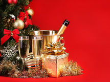 Christmas or New Year's Eve. Champagne and Presents Stock Images