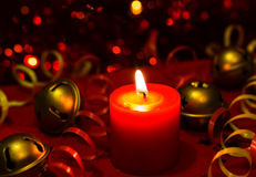 Christmas and New Year`s festive evening burning candle bokeh image. Royalty Free Stock Photos