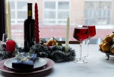 Holiday festive table set with christmas tree on background stock photography
