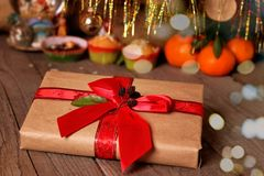 Christmas or New Year`s gift and decorations on a wooden background stock photos