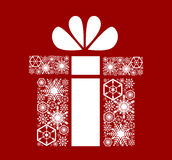 Christmas, New Year`s gift. White snowflakes on a red. Background Royalty Free Stock Photos
